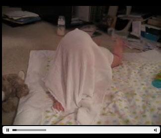 Anna playing peekaboo